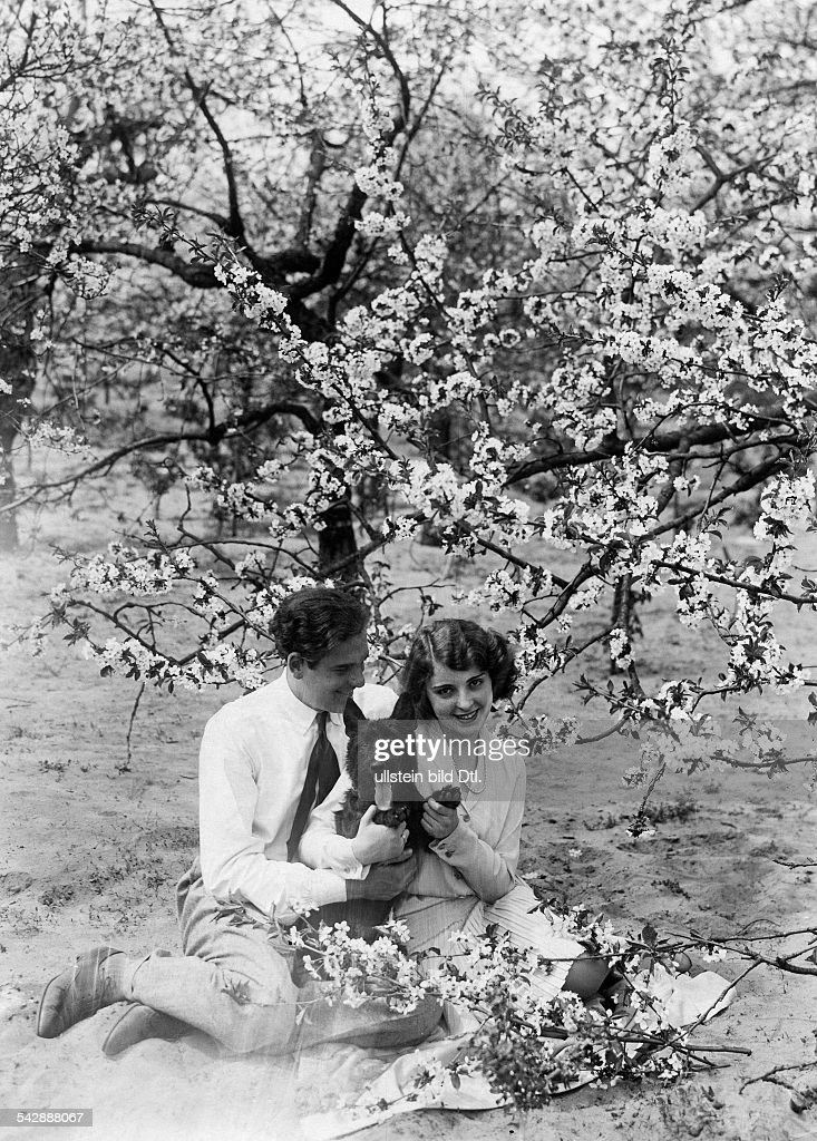 Jenny Jugo and Enrico Benfer under a cherry tree with blossoms. Brandenburg, Werder 1931