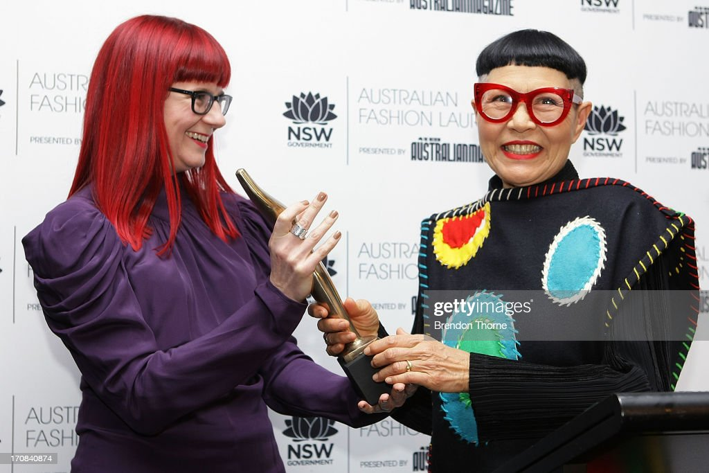 Jenny Kee receives her award from Glynis Trall-Nash after winning the Australian Fashion Laureate Award at the Pullman Grand Quay Hotel on June 19, 2013 in Sydney, Australia.