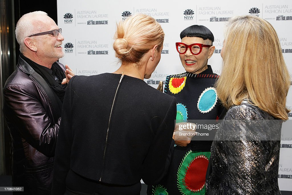 Jenny Kee speaks with fellow nominees, Heidi Middleton, Nicholas Huxley and Nancy Pilcher after winning the Australian Fashion Laureate Award at the Pullman Grand Quay Hotel on June 19, 2013 in Sydney, Australia.