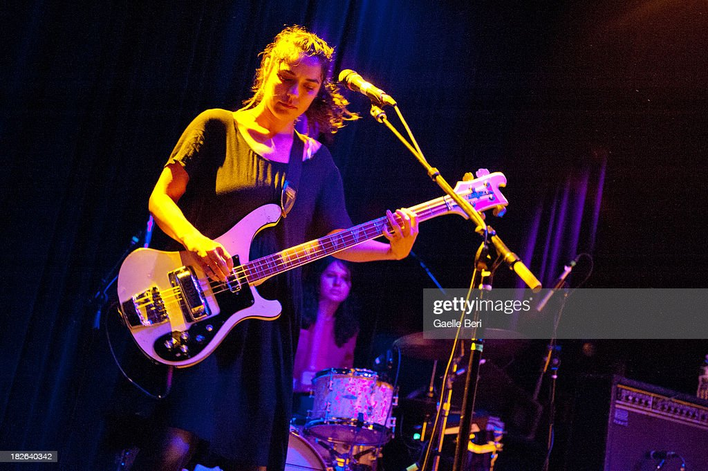 Jenny Lee Lindberg and Stella Mozgawa of Warpaint perform on stage at Music Hall of Williamsburg on October 1, 2013 in New York, New York.