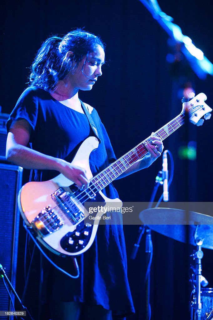 Jenny Lee Lindberg of Warpaint performs on stage at Music Hall of Williamsburg on October 1 2013 in New York New York