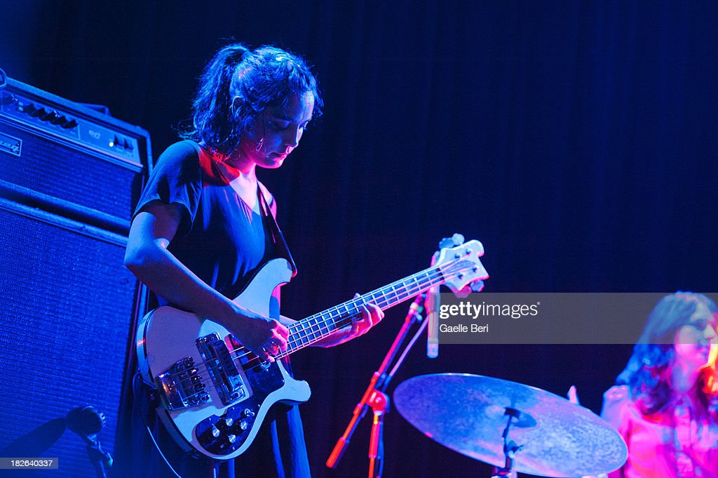 Jenny Lee Lindberg of Warpaint performs on stage at Music Hall of Williamsburg on October 1, 2013 in New York, New York.