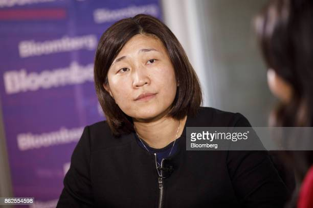 Jenny Lee managing partner of GGV Capital listens during a Bloomberg Television interview on the sidelines of the Wall Street Journal DLive global...