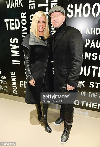 Jenny McCarthy and Donnie Wahlberg arrive for the Canadian launch of Wahlburgers Family Restaurant on November 15 2014 in Toronto Canada