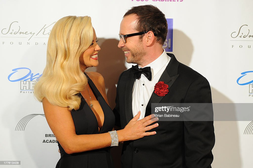 <a gi-track='captionPersonalityLinkClicked' href=/galleries/search?phrase=Jenny+McCarthy&family=editorial&specificpeople=202900 ng-click='$event.stopPropagation()'>Jenny McCarthy</a> and <a gi-track='captionPersonalityLinkClicked' href=/galleries/search?phrase=Donnie+Wahlberg&family=editorial&specificpeople=220537 ng-click='$event.stopPropagation()'>Donnie Wahlberg</a> attends the Dancing with the Stars Charity event hosted by <a gi-track='captionPersonalityLinkClicked' href=/galleries/search?phrase=Jenny+McCarthy&family=editorial&specificpeople=202900 ng-click='$event.stopPropagation()'>Jenny McCarthy</a> on August 24, 2013 at Hotel Baker in St Charles, Illinois.