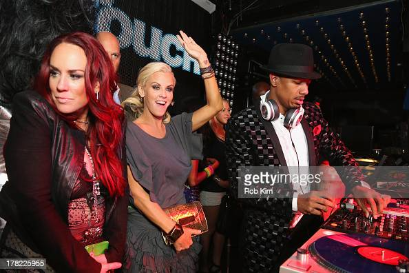 Jenny McCarthy and Nick Cannon attend Intouch Weekly's 'ICONS IDOLS Party' on August 25 2013 in New York United States
