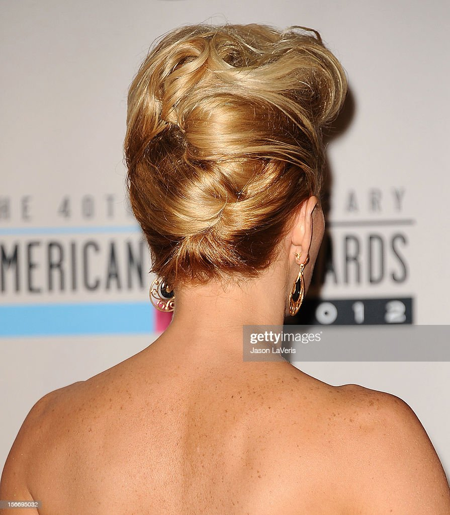 Jenny McCarthy (hair detail) poses in the press room at the 40th American Music Awards at Nokia Theatre L.A. Live on November 18, 2012 in Los Angeles, California.