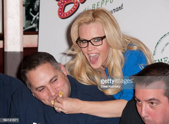 Jenny McCarthy with members of the NYPD Columbia Association attends the 2013 National Ravioli Day Pasta Eating Contest at Buca di Beppo on March 20...