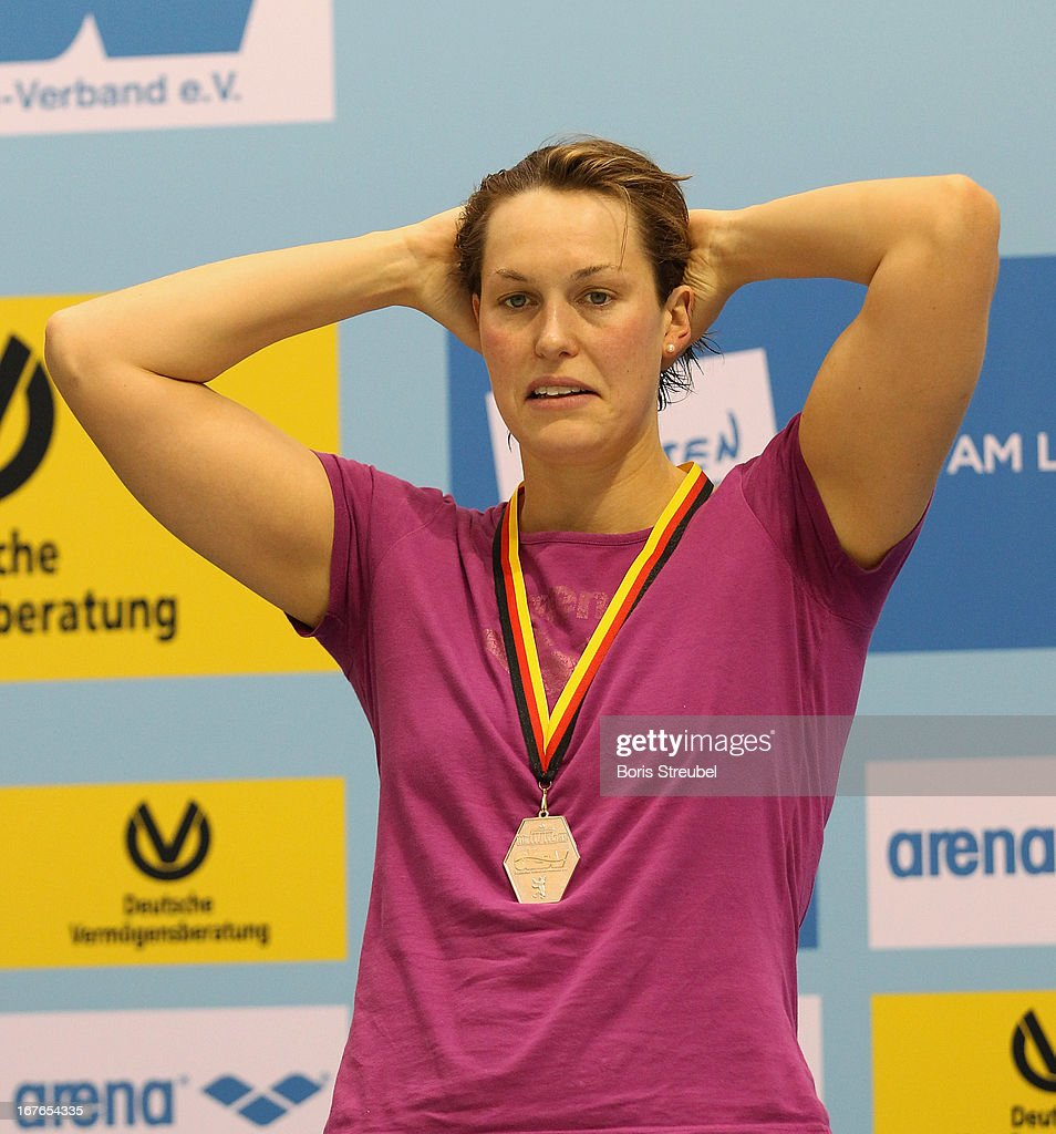 Jenny Mensing of SC Wiesbaden reacts on the podium after winning the silver medal for the women's 200m backstroke A final on day two of the German Swimming Championship 2013 at the Eurosportpark on April 27, 2013 in Berlin, Germany.
