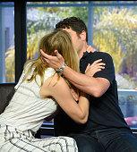 Jenny Mollen and Jason Biggs kiss at 'Extra' at Universal Studios Hollywood on July 25 2016 in Universal City California