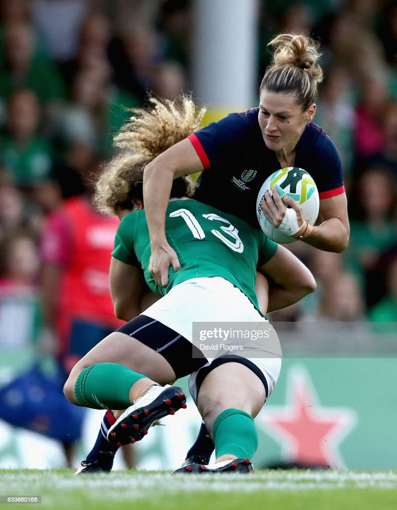 Jenny Murphy of Ireland tackles Caroline Ladagnous of France during the Women's Rugby World Cup Pool C match between France and Ireland at UCD Bowl on August 17, 2017 in Dublin, Ireland.