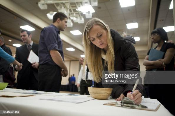 Jenny Pazar who is currently an intern fills out a form as she looks for a job at a job fair December 02 2011 in Portland Oregon The unemployment...