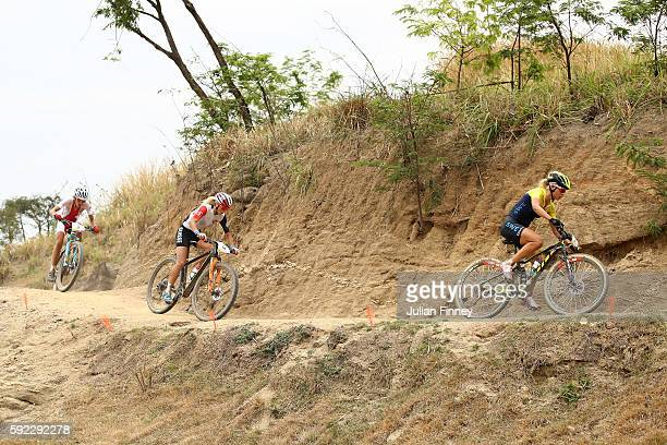 Jenny Rissveds of Sweden Maja Wloszczowska of Poland and Catharine Pendrel of Canda race during the Women's CrossCountry Mountain Bike Race on Day 15...