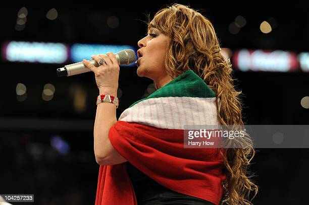 Jenny Rivera sings the Mexican national anthem before the Middleweight bout against Shane Mosley and Sergio Mora at Staples Center on September 18...