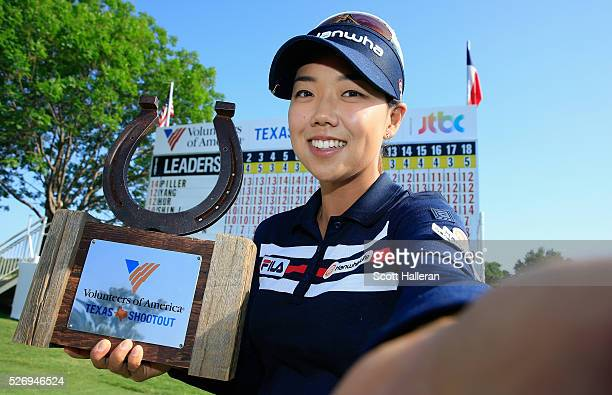 Jenny Shin poses for a simulated 'Selfie' with the trophy after her twostroke victory at the Volunteers of America Texas Shootout at Las Colinas...