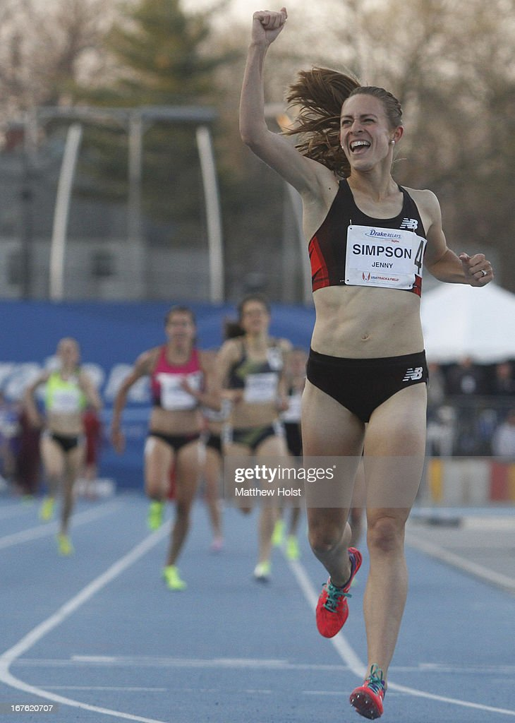 Jenny Simpson, of New Balance, celebrates as she crosses the finish line in the Women's 1500 Meter London Games Rematch at the Drake Relays, on April 26, 2013 at Drake Stadium, in Des Moines, Iowa.