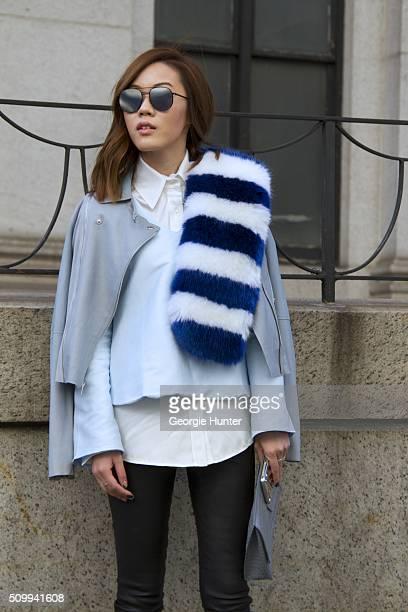 Jenny Tsang seen at The Arc Skylight at Moynihan Station outside the Tadashi Shoji show wearing Vince bag Paige Denim black leather pants and blue...