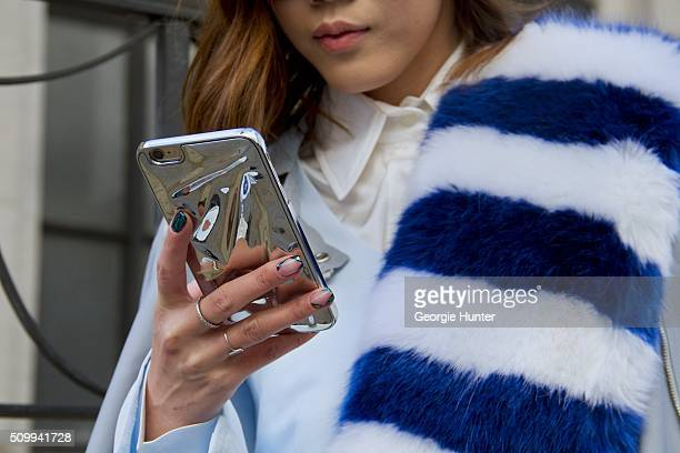 Jenny Tsang seen at The Arc Skylight at Moynihan Station outside the Tadashi Shoji show wearing Paige Denim blue jacket Charlotte Simone striped fur...