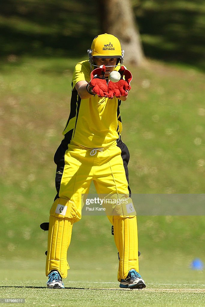 Jenny Wallace of the Fury fields a return throw during the WNCL match between the Western Australia Fury and the South Australia Scorpions at Christ Church Grammar Playing Fields on December 8, 2012 in Perth, Australia.