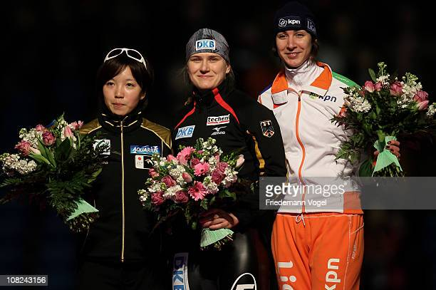 Jenny Wolf of Germany celebrates the first place on the podium with Nao Kodaira of Japan and Margot Boer of Netherlands after winning the 500m race...