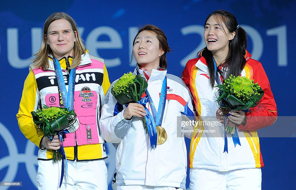 <a gi-track='captionPersonalityLinkClicked' href=/galleries/search?phrase=Jenny+Wolf&family=editorial&specificpeople=816675 ng-click='$event.stopPropagation()'>Jenny Wolf</a> of Germany poses after winning the silver, <a gi-track='captionPersonalityLinkClicked' href=/galleries/search?phrase=Lee+Sang-Hwa&family=editorial&specificpeople=4035584 ng-click='$event.stopPropagation()'>Lee Sang-Hwa</a> of South Korea the gold and <a gi-track='captionPersonalityLinkClicked' href=/galleries/search?phrase=Wang+Beixing&family=editorial&specificpeople=816965 ng-click='$event.stopPropagation()'>Wang Beixing</a> of China the bronze medal during the medal ceremony for the Ladies' 500m Speed Skating on day 6 of the Vancouver 2010 Winter Olympics at BC Place on February 17, 2010 in Vancouver, Canada.