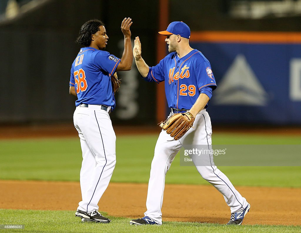 Jenrry Mejia #58 and <a gi-track='captionPersonalityLinkClicked' href=/galleries/search?phrase=Eric+Campbell&family=editorial&specificpeople=90797 ng-click='$event.stopPropagation()'>Eric Campbell</a> #29 of the New York Mets celebrate the win over the Chicago Cubs on August 15, 2014 at Citi Field in the Flushing neighborhood of the Queens borough of New York City.The New York Mets defeated the Chicago Cubs 3-2.