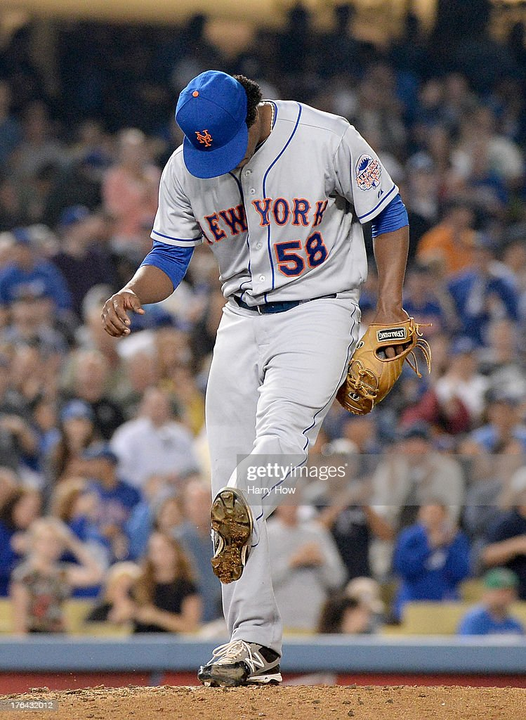 Jenrry Mejia #58 of the New York Mets reacts after the Los Angeles Dodgers tie the game 2-2 during the sixth inning at Dodger Stadium on August 12, 2013 in Los Angeles, California.
