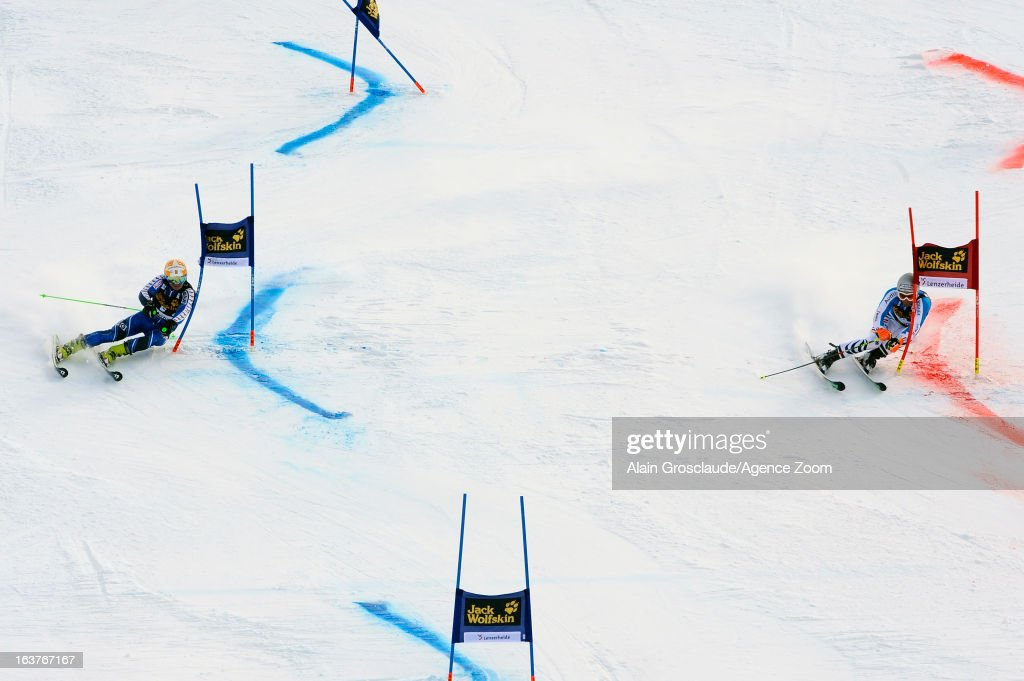 Jens Byggmark of Sweden competes against Fritz Dopfer of Germany during the Audi FIS Alpine Ski World Cup Nation's Team event on March 15, 2013 in Lenzerheide, Switzerland.