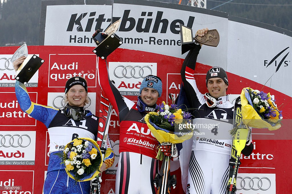 KITZBUEHEL, AUSTRIA - JANUARY 20, (FRANCE OUT) (L-R) Jens Byggmark of Sweden (2nd place), Jean- Baptiste Grange of France (1st place) and Mario Matt of Austria (3rd place) celebrate on the podium during the Alpine FIS Ski World Cup Men's Slalom on January 20, 2008 in Kitzbuehel, Austria.
