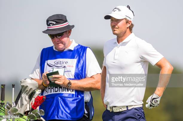 Jens Fahrbring of Sweden and his caddie are seen during day two of the Saltire Energy Paul Lawrie Matchplay at Golf Resort Bad Griesbach on August 18...