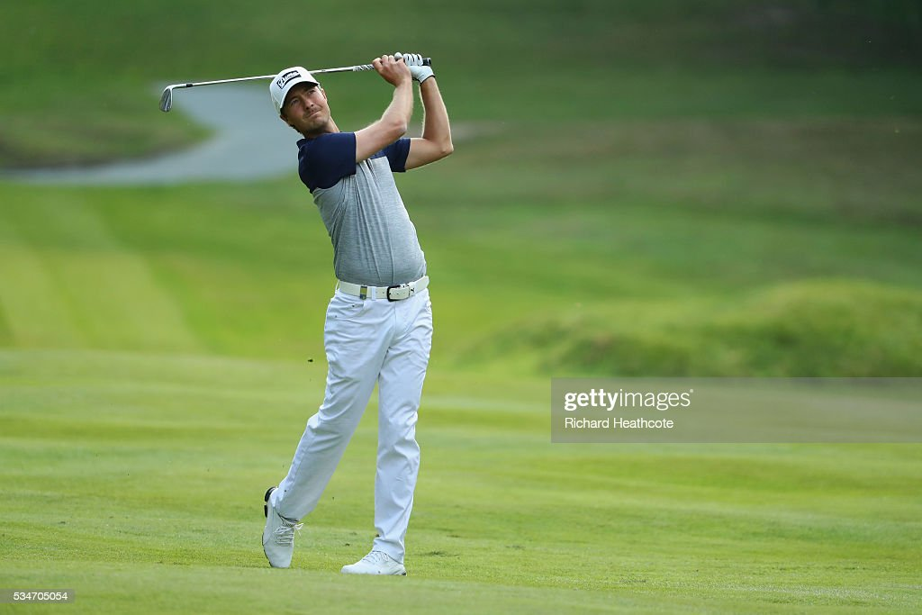 Jens Fahrbring of Sweden hits his 2nd shot on the 16th hole during day two of the BMW PGA Championship at Wentworth on May 27, 2016 in Virginia Water, England.
