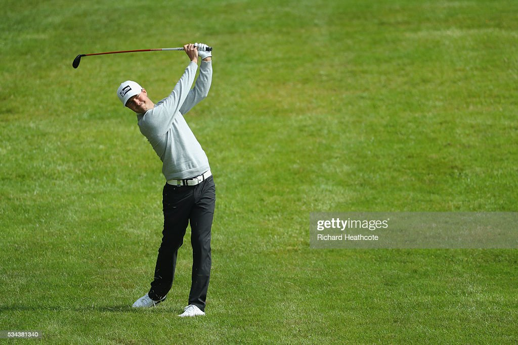 Jens Fahrbring of Sweden hits his 2nd shot on the 4th hole during day one of the BMW PGA Championship at Wentworth on May 26, 2016 in Virginia Water, England.