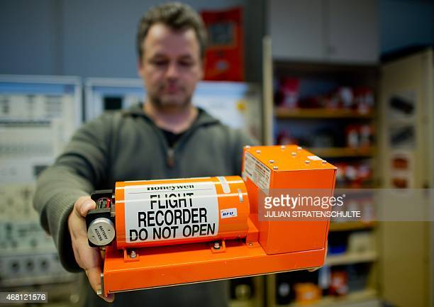 Jens Friedemann holds a flight recorder at the German Federal Bureau of Aircraft Accident Investigation in Braunschweig central Germany on March 30...