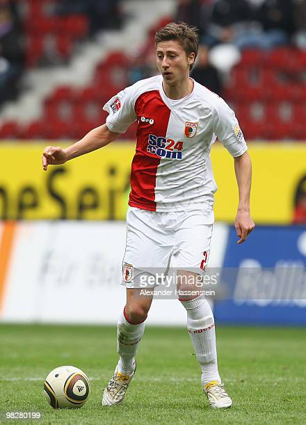 Jens Hegeler of Augsburg runs with the ball during the Second Bundesliga match between FC Augsburg and SpVgg Greuther Fuerth at Impuls Arena on April...