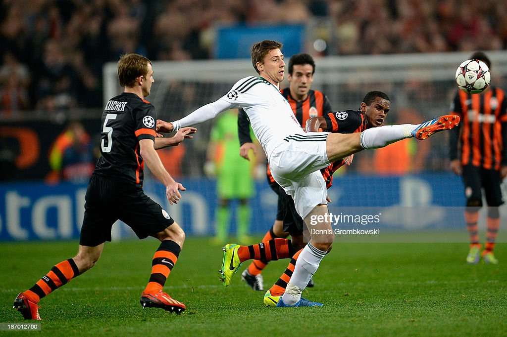 Jens Hegeler of Bayer Leverkusen vies for the ball under the pressure of Fernando of Shakhtar Donetsk during the UEFA Champions League Group A match between Shakhtar Donetsk and Bayer Leverkusen at Donbass Arena on November 5, 2013 in Donetsk, Ukraine.