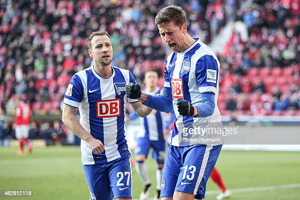 Jens Hegeler of Berlin celebrates his team's first goal with team mate Roy Beerens during the Bundesliga match between 1 FSV Mainz 05 and Hertha BSC...