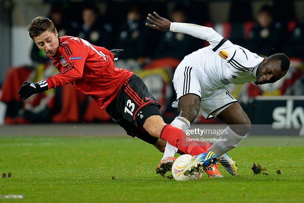 Jens Hegeler of Leverkusen and John Chibuike of Rosenborg Trondheim battle for the ball during the UEFA Europa League Group K match between Bayer 04 Leverkusen and Rosenborg Trondheim at BayArena on December 6, 2012 in Leverkusen, Germany.