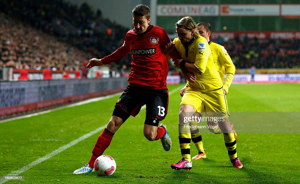 Jens Hegeler of Leverkusen and <a gi-track='captionPersonalityLinkClicked' href=/galleries/search?phrase=Marcel+Schmelzer&family=editorial&specificpeople=5443925 ng-click='$event.stopPropagation()'>Marcel Schmelzer</a> of Dortmund battle for the ball during the Bundesliga match between Bayer 04 Leverkusen and Borussia Dortmund at BayArena on February 3, 2013 in Leverkusen, Germany.