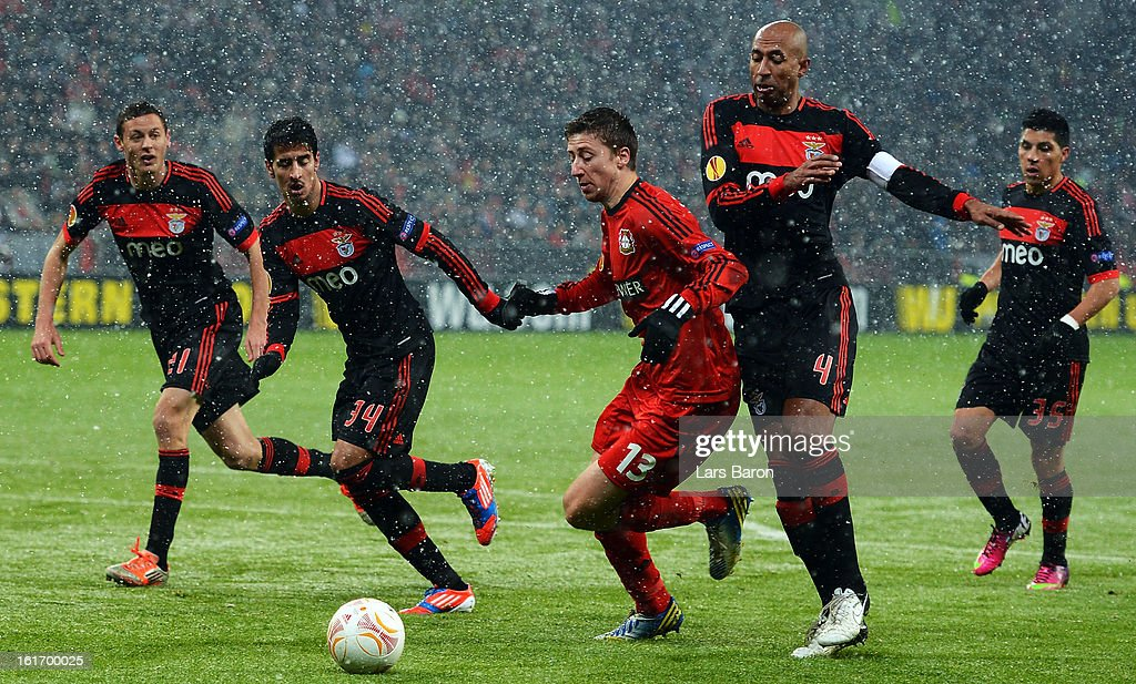 Jens Hegeler of Leverkusen is challenged by Luisao of Benfica during the UEFA Europa League Round of 32 first leg between Bayer 04 Leverkusen and SL Benfica at BayArena on February 14, 2013 in Leverkusen, Germany.