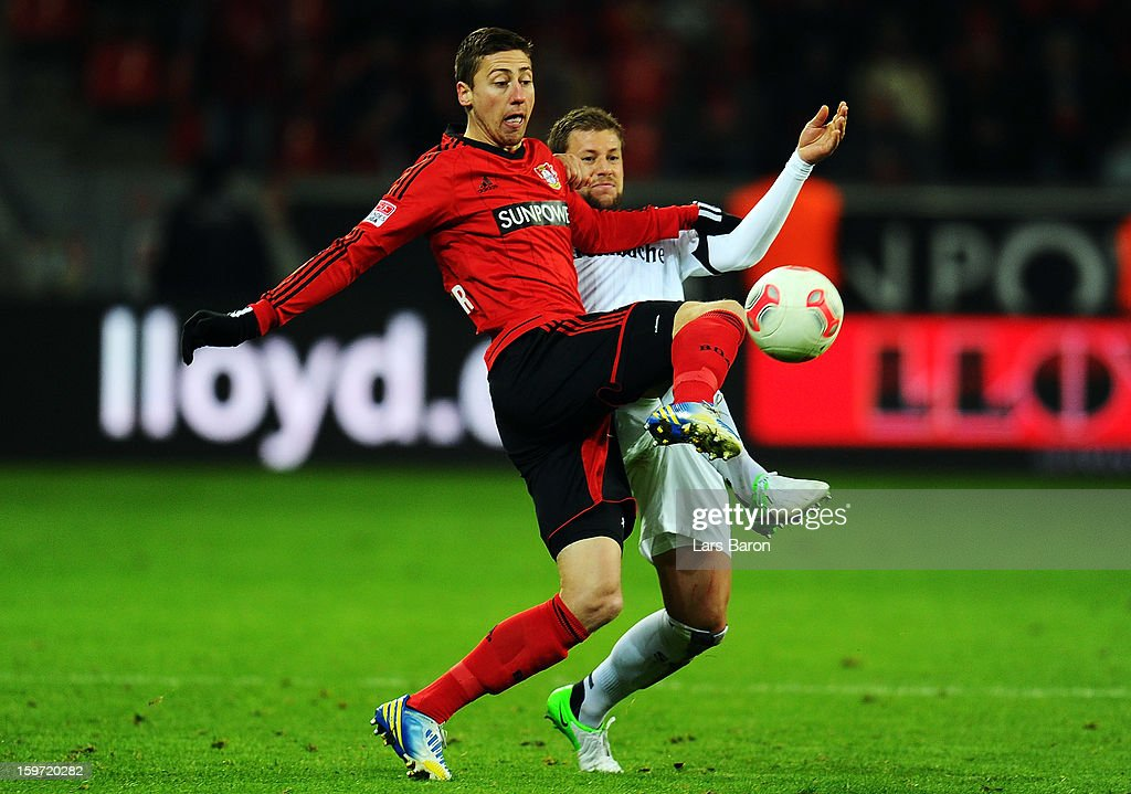 Jens Hegeler of Leverkusen is challenged by <a gi-track='captionPersonalityLinkClicked' href=/galleries/search?phrase=Marco+Russ&family=editorial&specificpeople=653868 ng-click='$event.stopPropagation()'>Marco Russ</a> of Frankfurt during the Bundesliga match between Bayer 04 Leverkusen and Eintracht Frankfurt at BayArena on January 19, 2013 in Leverkusen, Germany.