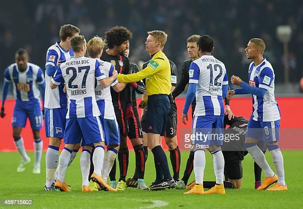 Jens Hegeler Roy Beerens Per Skjelbred Dante referee Christian Dingert Thomas Mueller Ronny and Marcel Ndjeng of Hertha BSC argue during the game...
