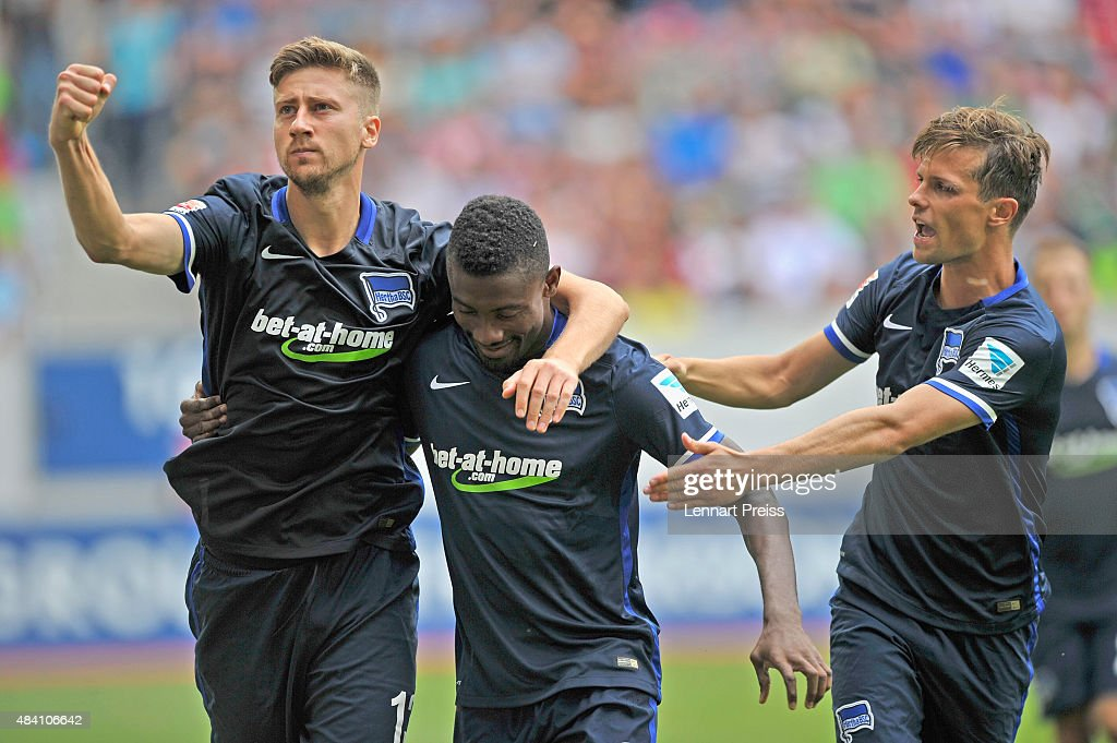 Jens Hegeler (L-R), Salomon Kalou and Valentin Stocker of Hertha BSC celebrate the opening goal during the Bundesliga match between FC Augsburg and Hertha BSC at WWK-Arena on August 15, 2015 in Augsburg, Germany.