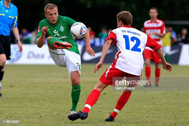 Jens Helming of Meppen and Lennart Thy of Bremen battle for the ball during the friendly match between SV Meppen and SV Werder Bremen on July 6 2011...