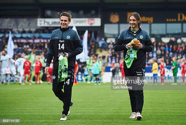 Jens Jakob Thomasen and Rasmus Falk of OB Odense walk on to the pitch prior to the Danish Alka Superliga match between Sonderjyske and OB Odense at...