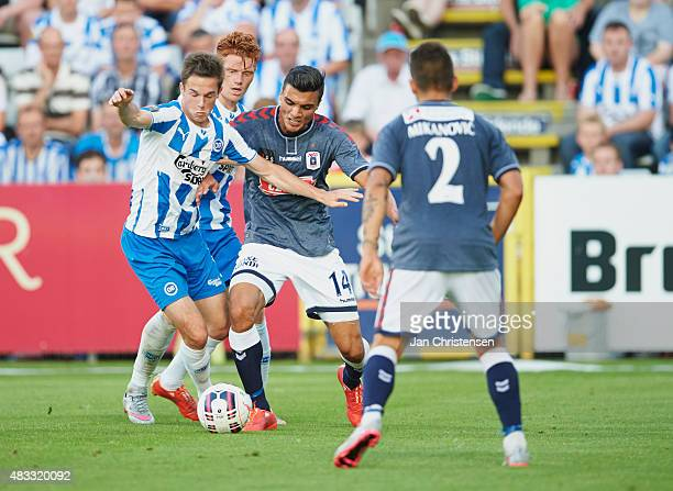 Jens Jakob Thomasen of OB Odense and Ahmed Yasin of AGF Arhus compete for the ball during the Danish Alka Superliga match between OB Odense and AGF...