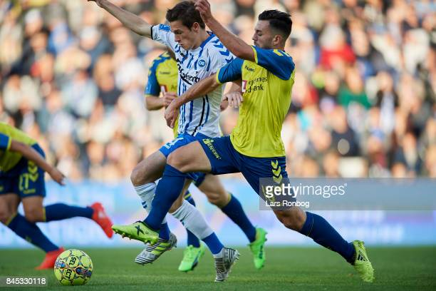 Jens Jakob Thomasen of OB Odense and Besar Halimi of Brondby IF compete for the ball during the Danish Alka Superliga match between OB Odense and...