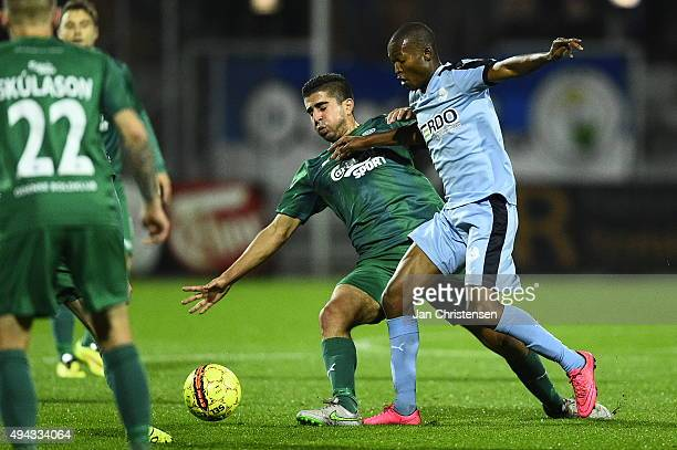 Jens Jakob Thomasen of OB Odense and Mandla Masango of Randers FC compete for the ball during the Danish Alka Superliga match between Randers FC and...