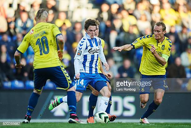 Jens Jakob Thomasen of OB Odense and Thomas Kahlenberg of Brondby IF compete for the ball during the Danish Alka Superliga match between Brondby IF...