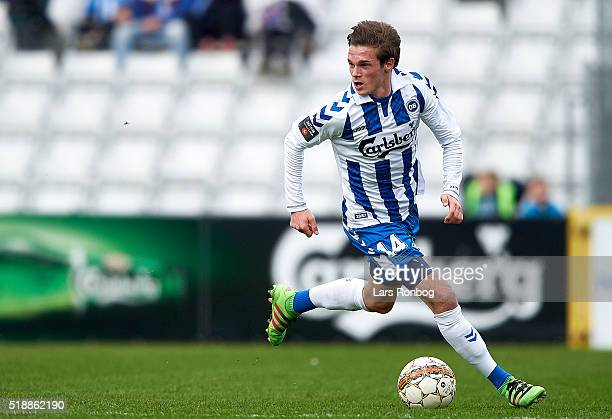 Jens Jakob Thomasen of OB Odense controls the ball during the Danish Alka Superliga match between OB Odense and Randers FC at TreFor Park on April 3...
