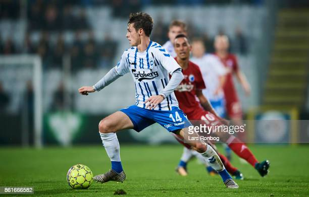 Jens Jakob Thomasen of OB Odense controls the ball during the Danish Alka Superliga match between OB Odense and FC Copenhagen at EWII Park on October...
